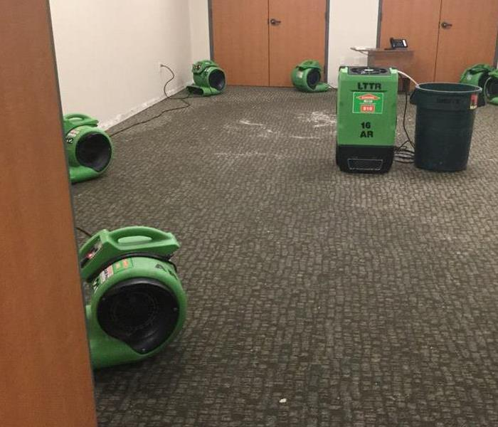 Soaked Carpet in Office Building After