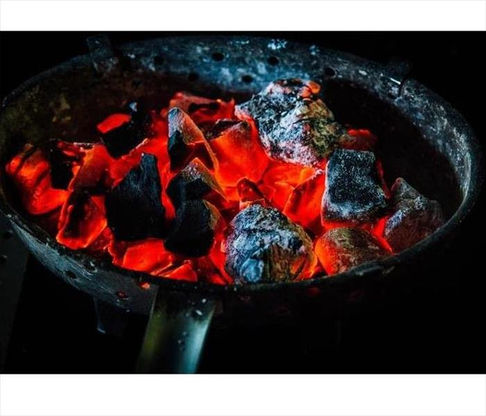 Burning charcoal in barbecue grill