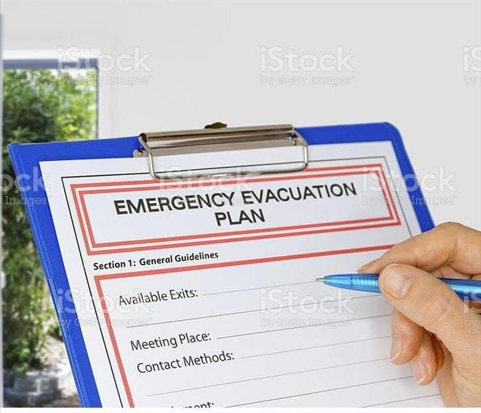 Clipboard with fire evacuation plan written on it
