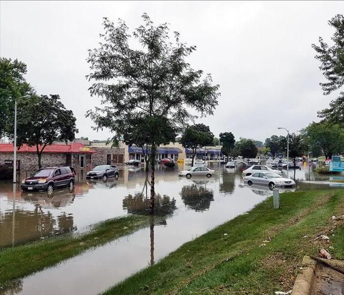 Cars in flooded parking lot