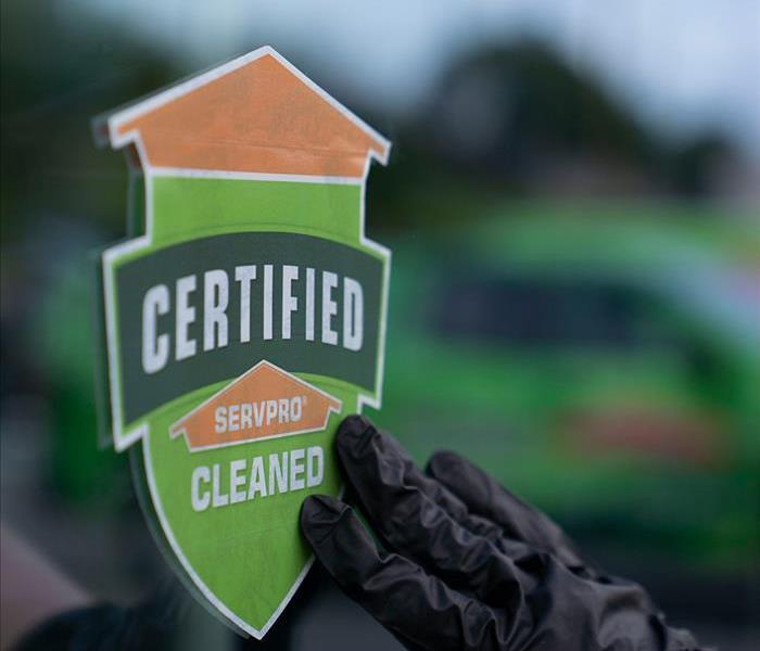 Certified: SERVPRO® Cleaned sign on window