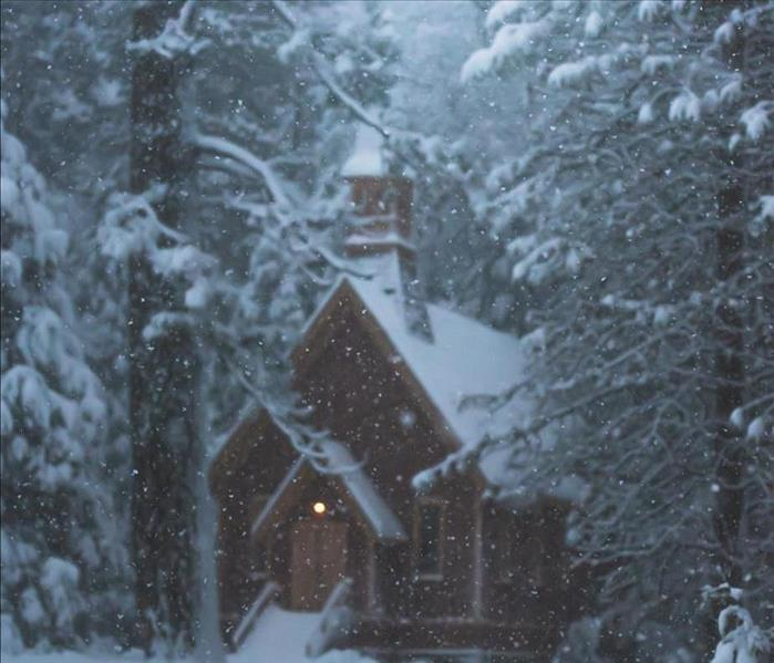 House in winter woods